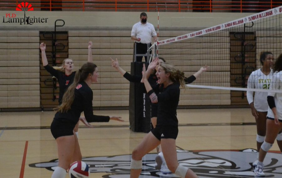 Upon scoring a point, team members celebrate Isabella Haggard as she scores another point for your PLD Dawgs.